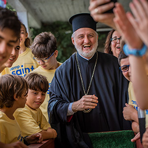 Archbishop Elpidophoros Receives Enthusiastic Welcome at Camp Saint Paul